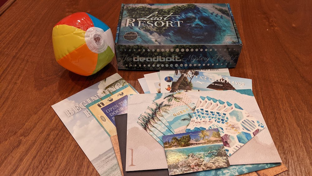Deadbolt Last Resort box beside an inflated beach ball and an assortment of colorful paper puzzle items.