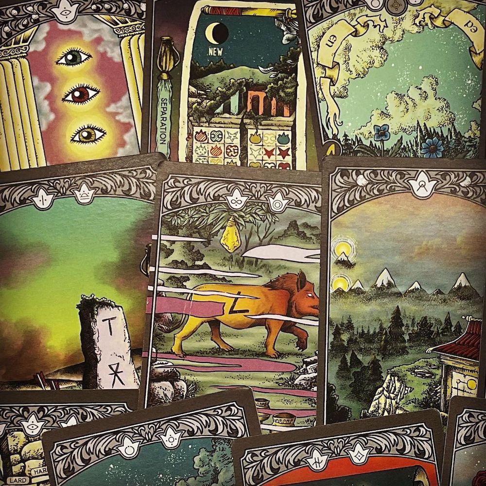 An assortment of beautifully illustrated tarot cards.