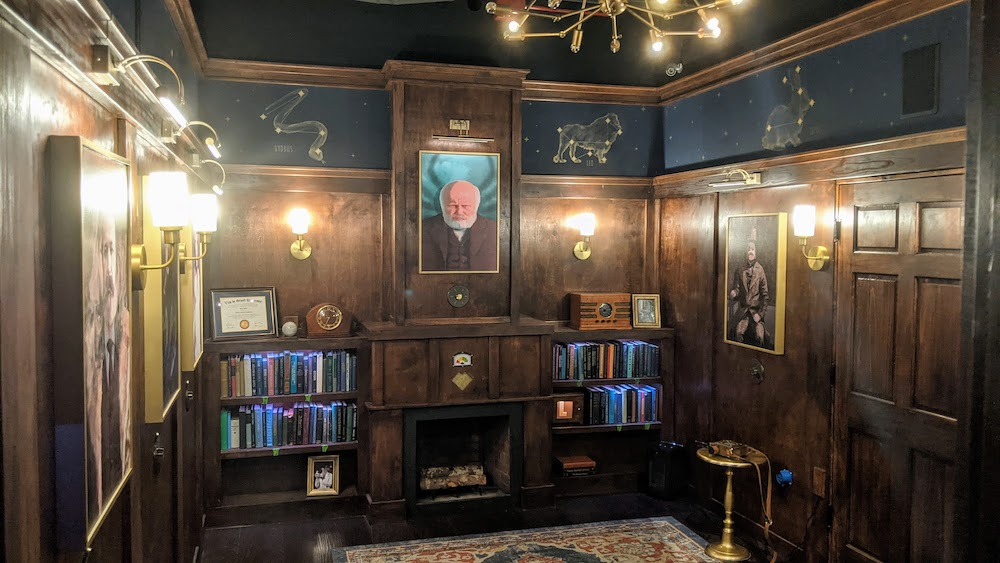 An elegant old study with zodiac symbols painted on the walls.