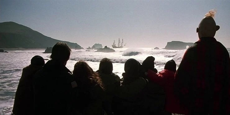 Final scene of the Goonies, the gang watches as a ship sails off in the distance.
