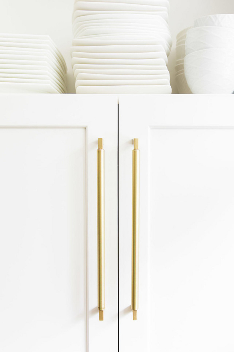 brass-and-white-kitchen-cabinet