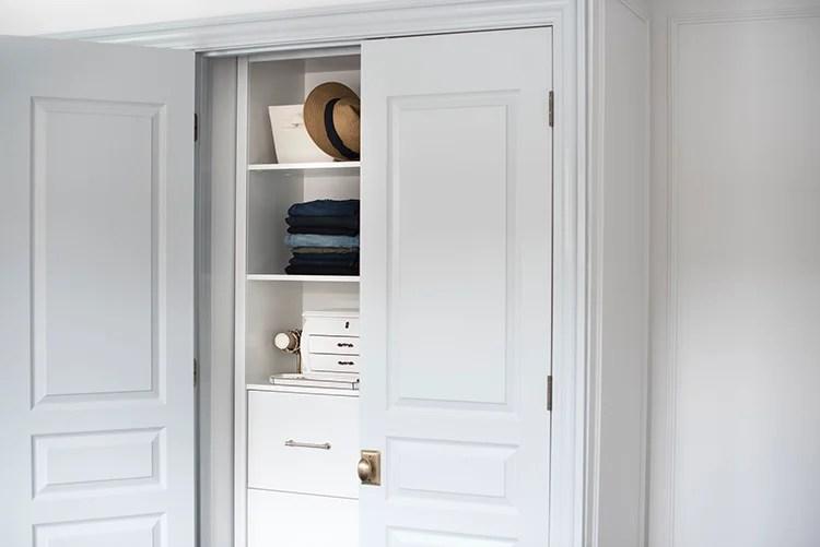 Custom Closet System Behind French Doors