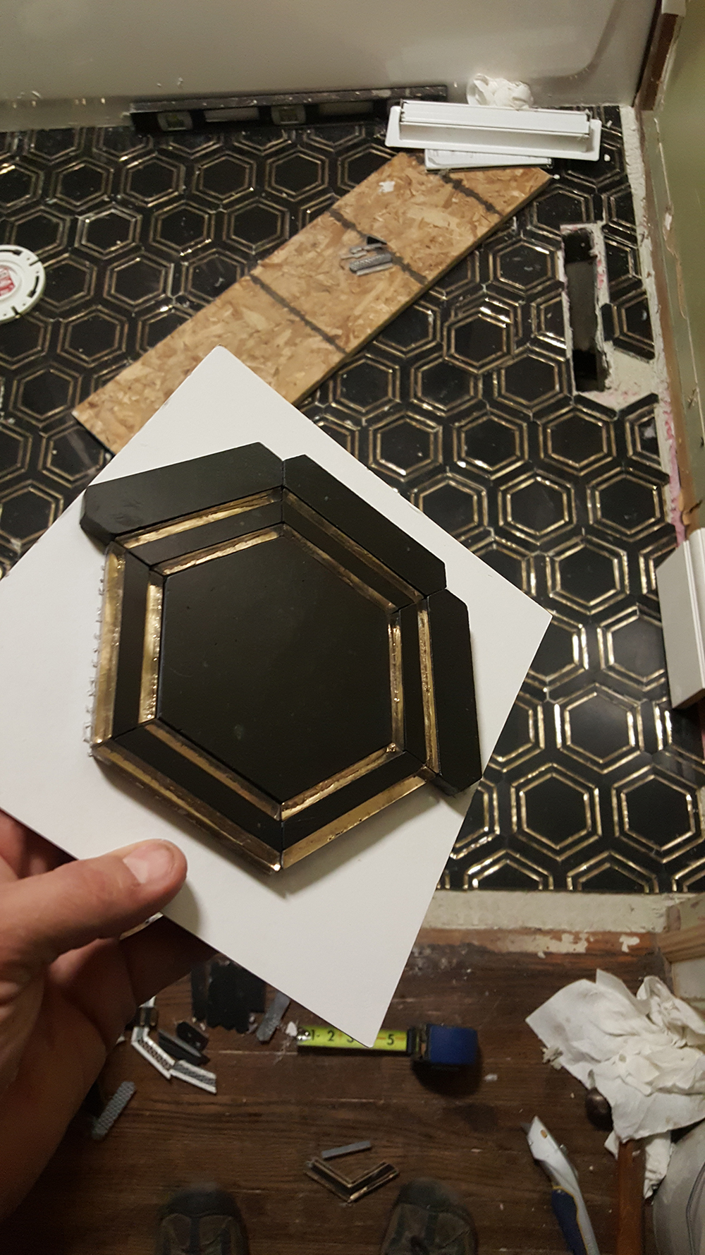 black hex floor tile in progress