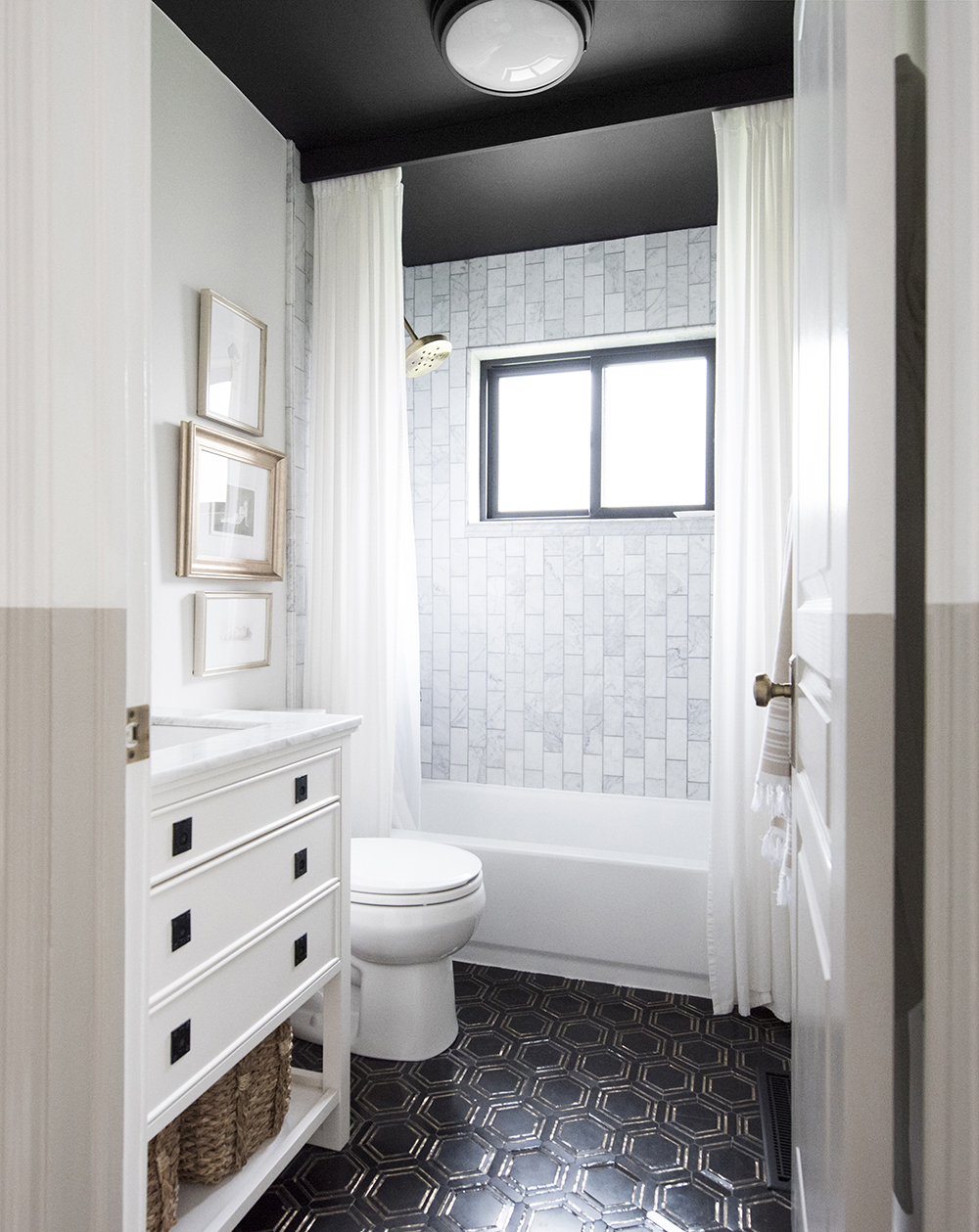 Bathroom with Black and Brass Floor Tile - roomfortuesday.com