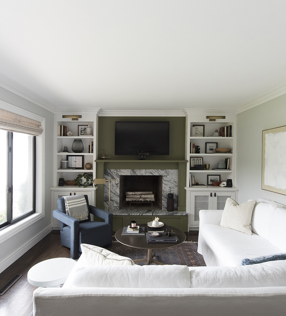 Living Room with Marble Fireplace and Built-in Shelving with White Sofa - roomfortuesday.com