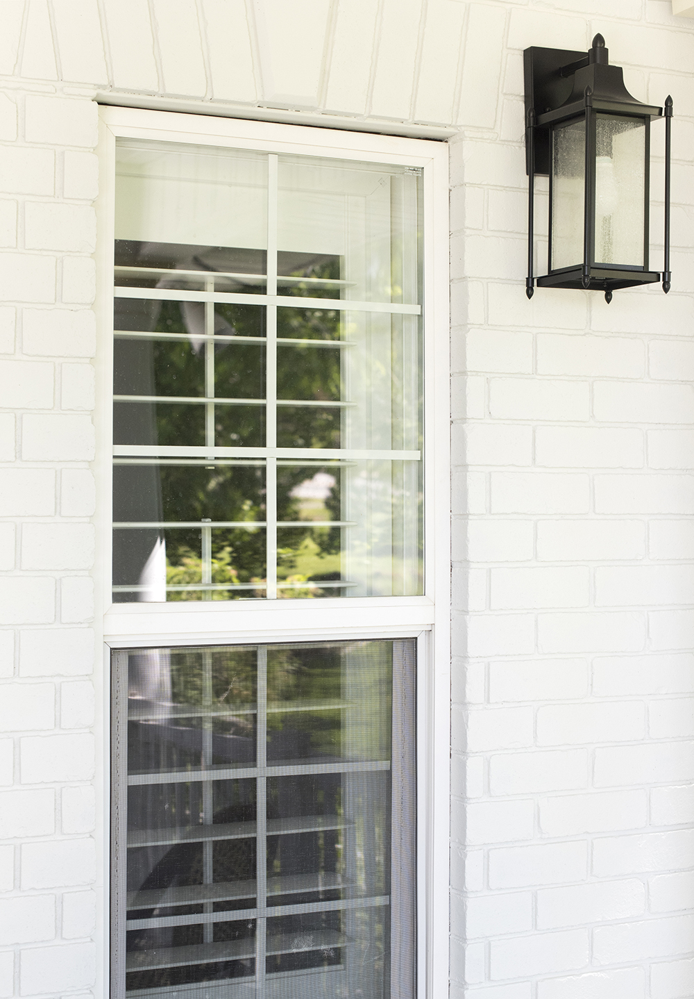 white painted brick on patio room for