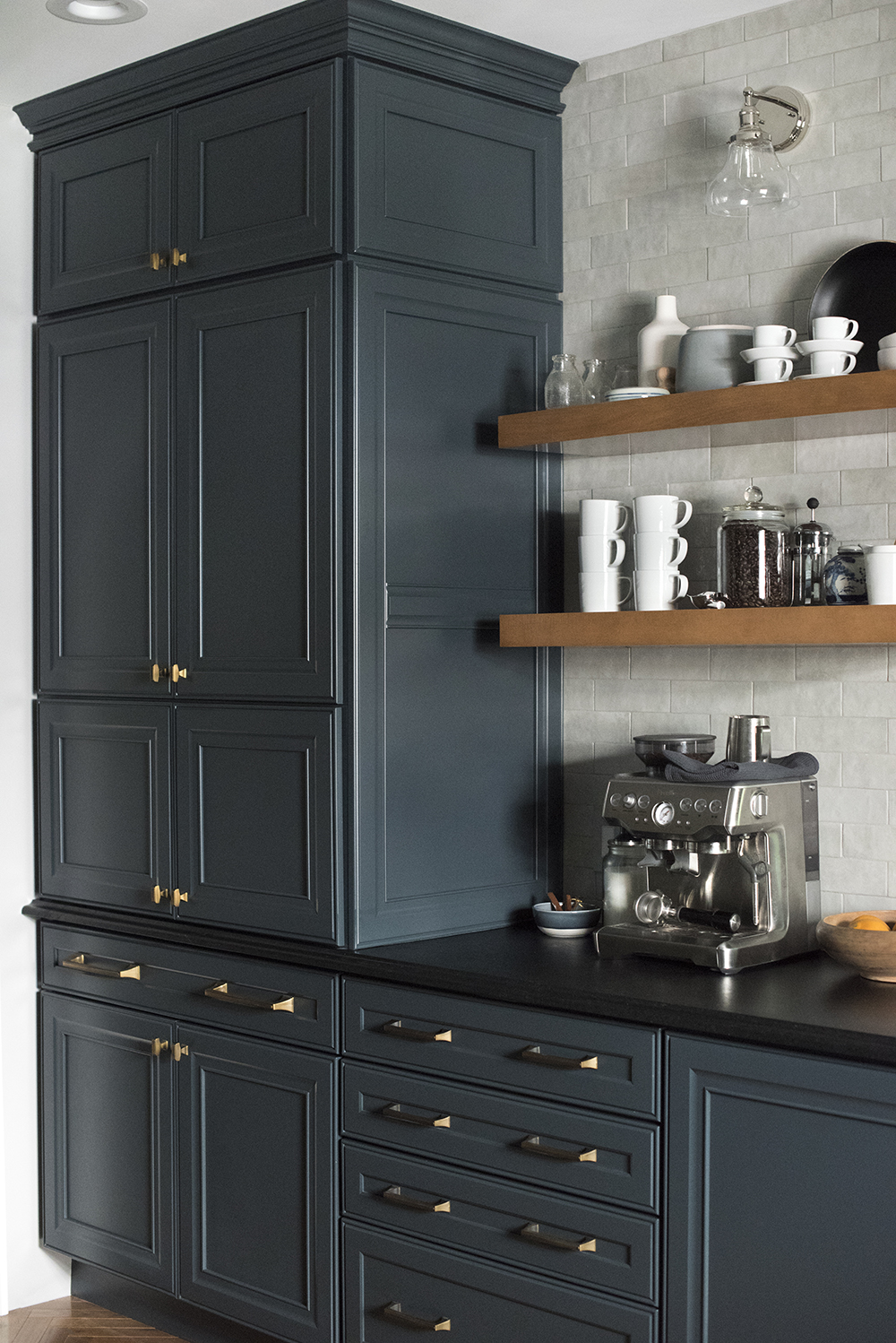 large pantry cabinet and coffee bar in dark kitchen - room