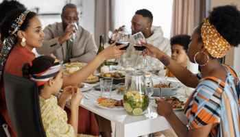 family having dinner and celebrating