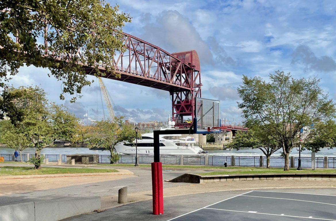 Yachts Cruise Under the Roosevelt Island Bridge. Everyone Else Waits