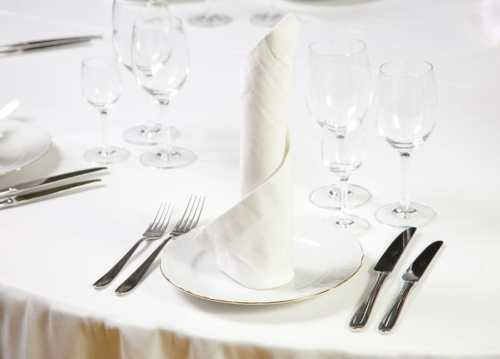 Place setting with candle napkin