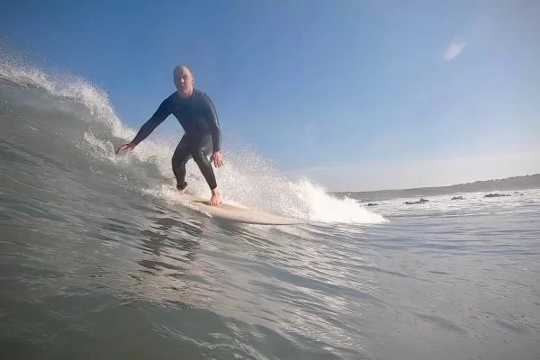 Close up of Liam surfing