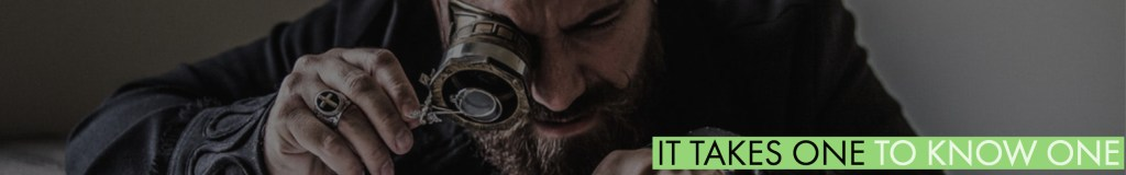 Man looking through a magnification device.
