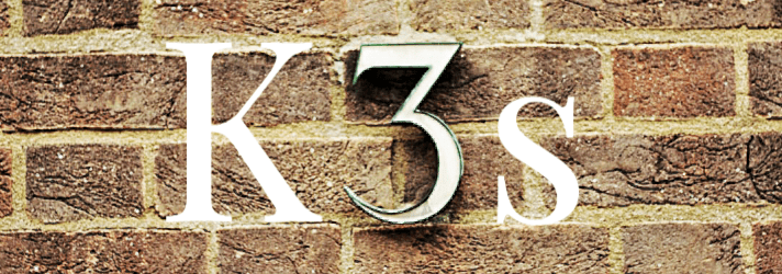 "Brick wall with the letter ""K"" number ""3"" and the letter ""s"" that represents K3s"