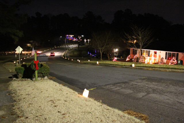 Neighborhood luminarias (white paper bags filled with candles line all the streets - it helps Santa Claus find us)