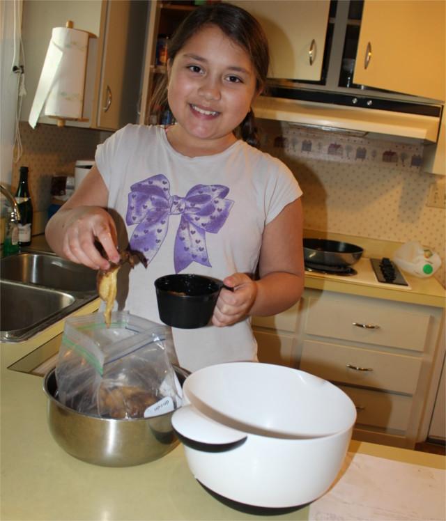 Teaching the kids how to make banana bread.
