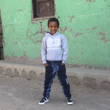 Dawit Arega SS student in Bonosha receiving his school clothing Feb 2018