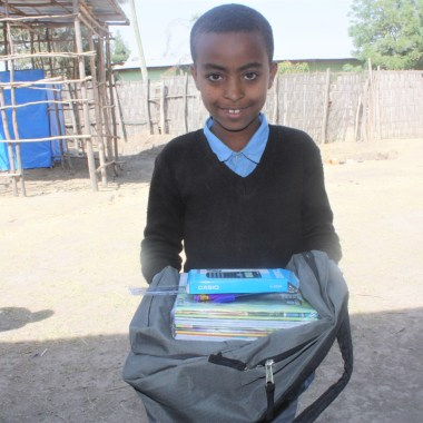 Yeabsira Ambiko new SS student in Bonosha with his school supplies in Feb 2018