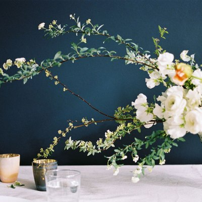 An organic wedding floral display with organic shapes and greenery