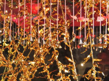Silver bells around the wedding canopy.