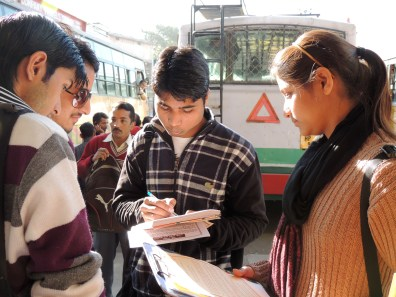 Mamta, a volunteer from Shahpur, helps distribute info.