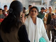 Bhavna, the girl in white, confronts her fellow coworkers and asks them why they don't help her.
