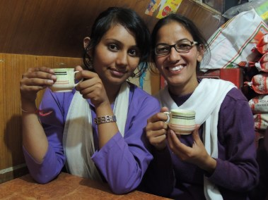New volunteer Anshi from Chandigar (left) and Vandana, Jagori team member, enjoy tea after work.