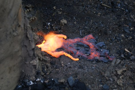 The bloomery furnace, molten slag seeps out