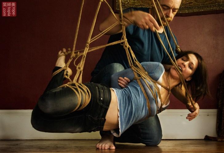 Low level shibari suspension by WykD Dave. Nina Russ enjoying expert shibari. Photo by Clover