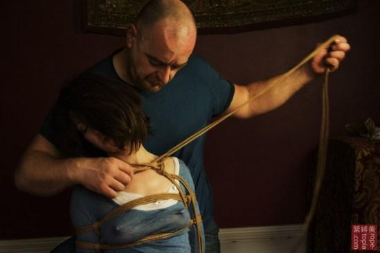 WykD Dave tying Nina Russ, aroused in shibari bondage. Photography by Clover