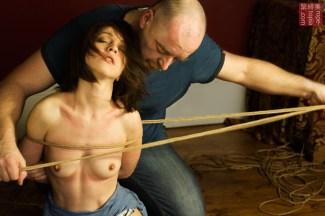 Untying Nina Russ in shibari bondage session Photography by Clover