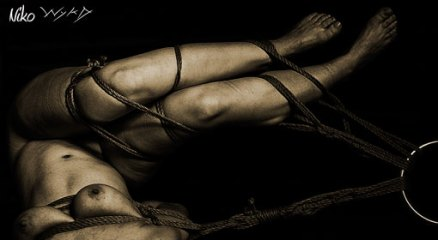 Twisted shibari suspension.