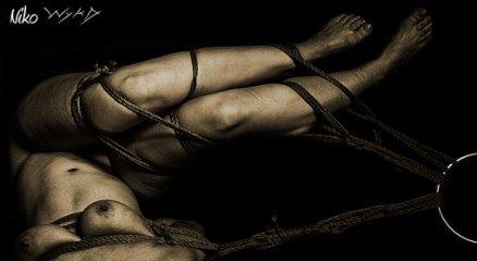 Twisted shibari suspension.