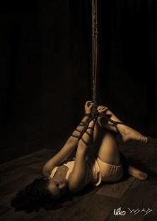 Molly Dolly tied to Bamboo in shibari bondage