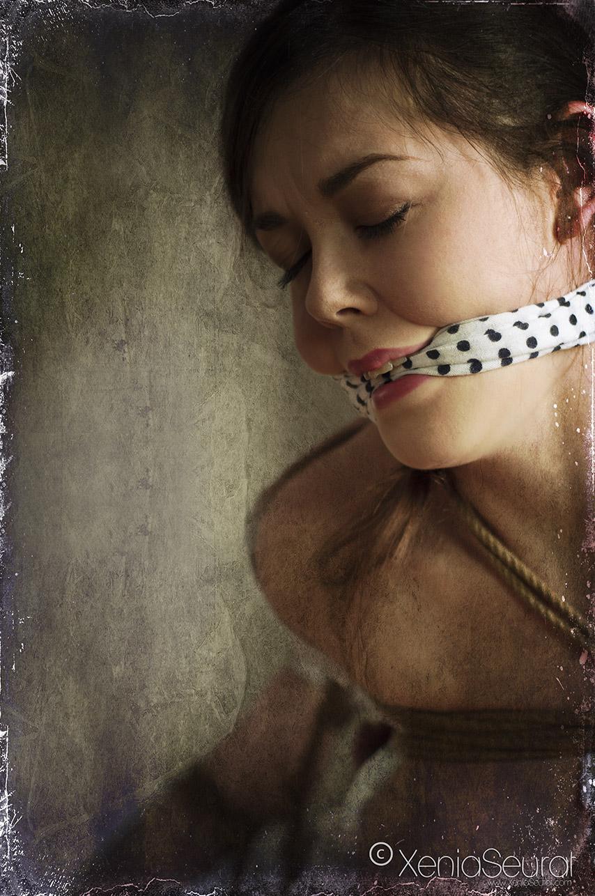 Bound and gagged in shibari rope bondage