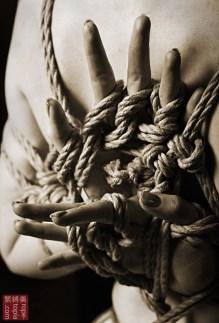 Yubi shibari, finger bondage.