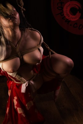 Image of stress and acceptance in shibari bondage