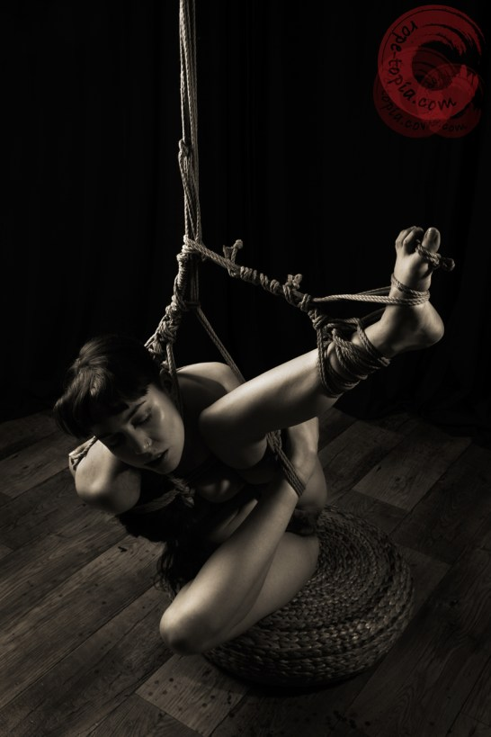 Twisted model shibari partial suspension