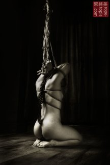 Bound and kneeling yubi shibari, fingers bound