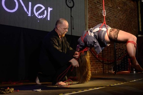 Shibari bondage performance at Bondage Expo Dallas at the Church Dallas in 2016. Lingerie and drop in transitions.0