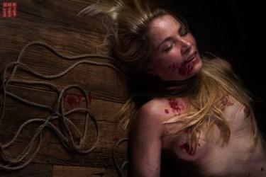 Iongantas. Exhasted after intense shibari session wax,hair, rope.
