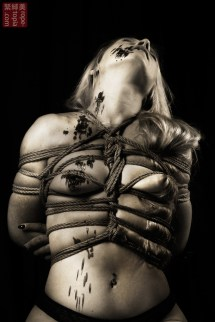 Shibari bondage, hair bondage, hot wax, floor work. Serious kinbaku