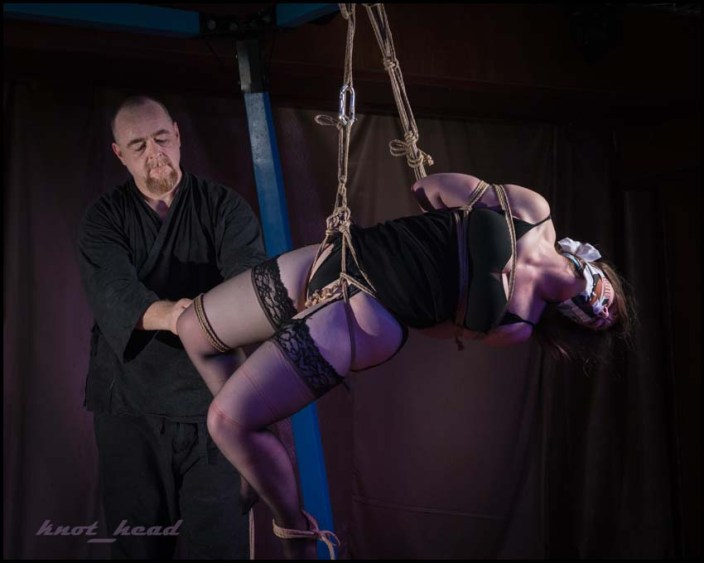 Shibari rope bondage performance at Beach Bind at Hedonism II in Jamaica with WykD Dave & Clover. Intense reverse prayer suspension. Images copyright knot_head