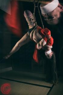 Inverted bondage stress. Model Ankrah.