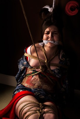 Angry and afraid, bound in kimono. Model Alexa