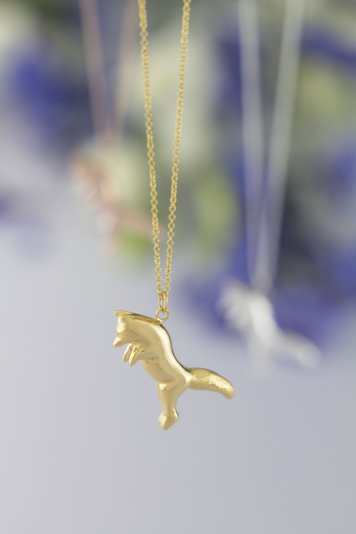 Pouncing fox necklace gold