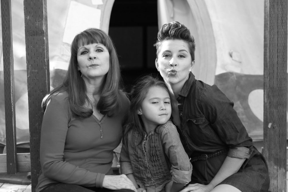 Black and white family photo of three generations of women, including the youngest, a little girl