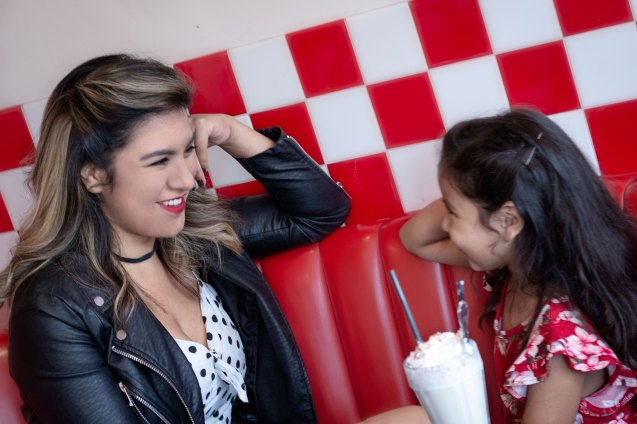 Mother and daughter smiling at each other at Busy Bee Cafe in Ventura, CA