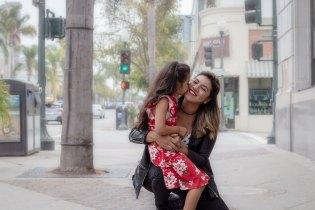 Daughter kissing mother in Downtown Ventura, CA