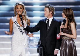 """Hosts Billy Bush, center, and Nadine Velazquez, right, listen as Miss California Carrie Prejean, left answers a question from judge Perez Hilton, unseen, about legalizing same-sex marriage during the Miss USA Pageant, Sunday April 19, 2009 in Las Vegas. """"We live in a land where you can choose same-sex marriage or opposite marriage,"""" Prejean said. """"And you know what, I think in my country, in my family, I think that I believe that a marriage should be between a man and a woman. No offense to anybody out there, but that's how I was raised."""" (AP Photo/Eric Jamison) Original Filename: Miss_USA_NVEJ114.jpg"""