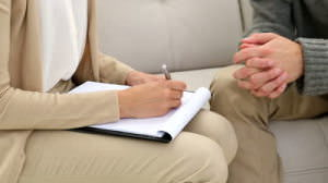 stock-footage-young-man-talking-with-his-therapist-at-therapy-session